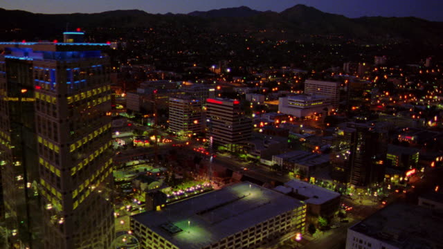 aerial mormon temple, capitol building + skyline of salt lake city at dawn/dusk / mountains in background - salt lake city stock videos & royalty-free footage
