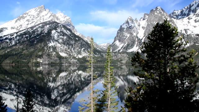 morning at jenny lake in teton national park, wyoming, pan - may stock videos & royalty-free footage