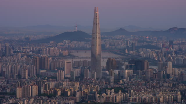 morning cityscape around lotte world tower, seoul, south korea - river han stock videos & royalty-free footage
