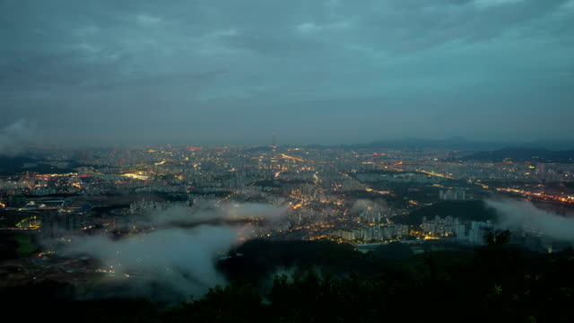 morning cloud sea over namhansanseong (mountain fortress) downtown district at dawn / seoul, south korea - architectural feature stock videos & royalty-free footage