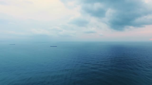 Morning clouds over the sea at sunrise, aerial video