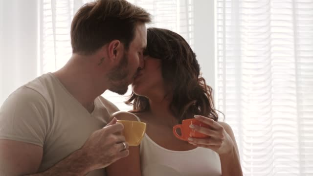 morning coffee, embraces and kisses - mid adult couple stock videos & royalty-free footage