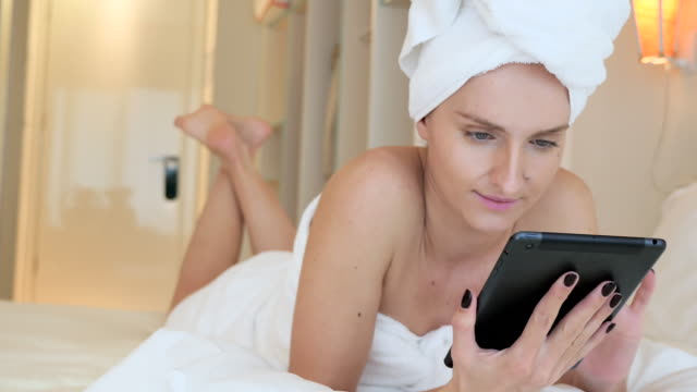 morning communication & tablet - wearing a towel stock videos and b-roll footage