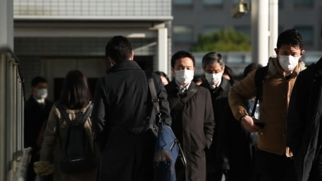 morning commuters make their way to work in tokyo japan on monday march 9 2020 - japan bloomberg stock videos & royalty-free footage