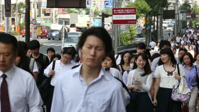 Morning commuters make their way to work in Tokyo Japan on Thursday July 16 2014