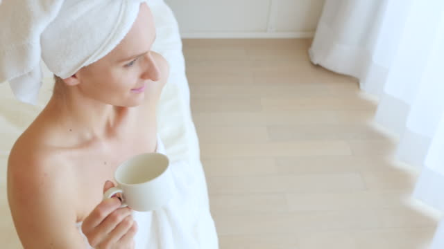 morning cup of tea/coffee - wrapped in a towel stock videos & royalty-free footage