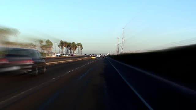 morning drive along the oil fields - huntington beach california stock videos and b-roll footage