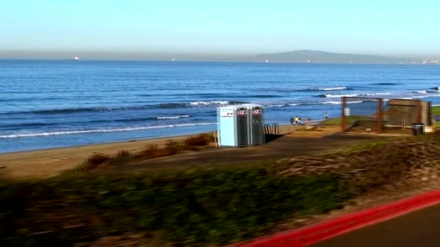 morning drive on pacific coast highway in california - huntington beach california stock videos and b-roll footage