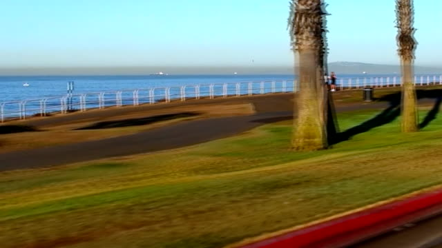 morning excercise at the beach - walkway - huntington beach california stock videos and b-roll footage