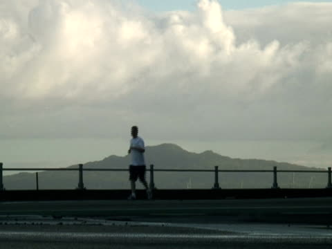 Morning Exercise: Silhouette Running to Left