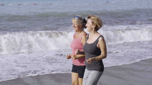 morning exercising on the beach - early morning exercise stock videos & royalty-free footage
