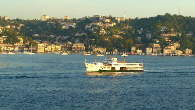 morning ferry in the bosphorus strait against the background of the cityscape - bosphorus stock videos & royalty-free footage