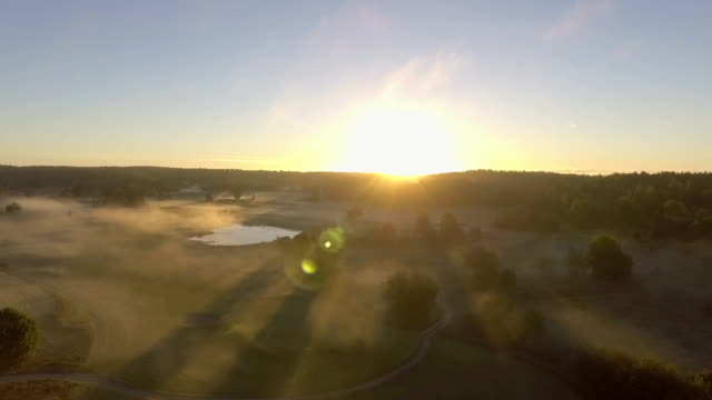 morning fog aerial - golf course stock videos & royalty-free footage
