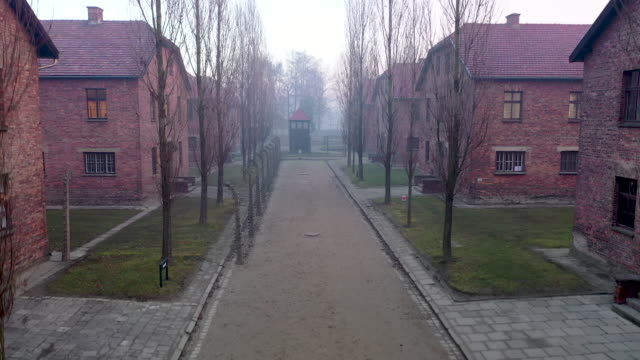 a morning fog blankets the electric fence and security lights that surround the auschwitz i extermination camp on december 18 2019 in oswiecim poland... - concentration camp stock videos & royalty-free footage