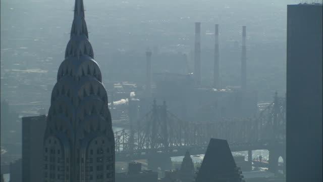 morning fog conceals manhattan. - chrysler building stock videos & royalty-free footage