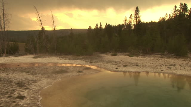 stockvideo's en b-roll-footage met ms, morning glory pool at sunset, upper geyser basin, yellowstone national park, wyoming, usa - sepiakleurig