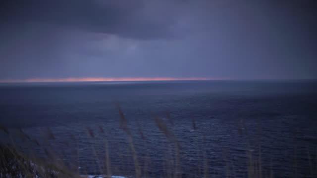 morning glow through clouds, aomori, japan - winter点の映像素材/bロール