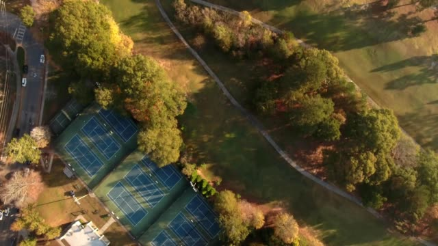 morning light nadir tennis court into golf scape - atlanta georgia stock videos & royalty-free footage
