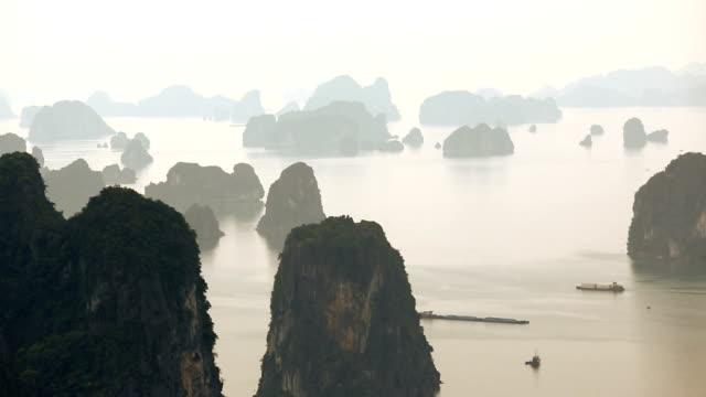 morning mist ha long bay limestone karsts unesco region north vietnam  - karst formation stock videos & royalty-free footage