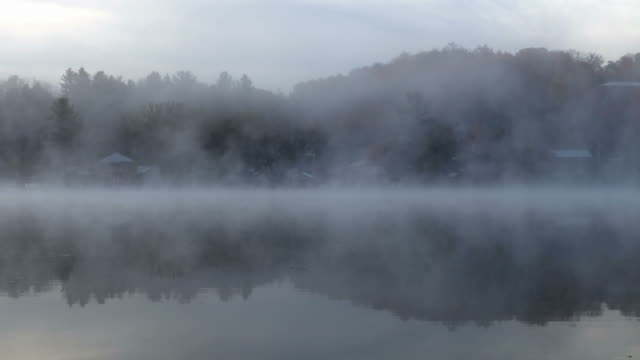 morning mist on saranac lake, new york - village stock videos & royalty-free footage