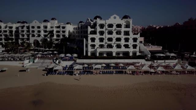 morning over medano beach, cabo san lucas, mexico. - pueblo bonito stock videos & royalty-free footage
