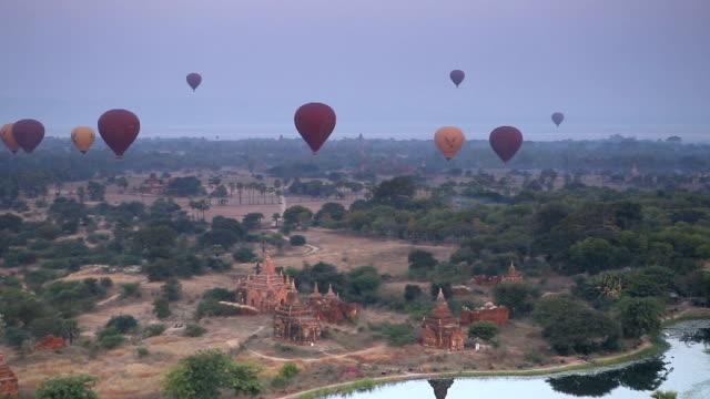 morning panorama of hot air balloons in bagan myanmar - bagan stock videos & royalty-free footage