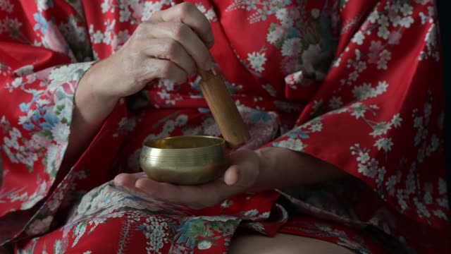 morning ritual meditating with sound bowl - traditionally tibetan stock videos & royalty-free footage