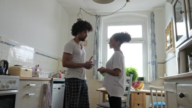 morning routine, couple in kitchen - loft apartment stock videos & royalty-free footage