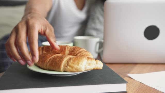 morning routine in living room - croissant stock videos & royalty-free footage