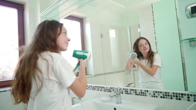 morning routine of a teenage girl - hair care stock videos & royalty-free footage