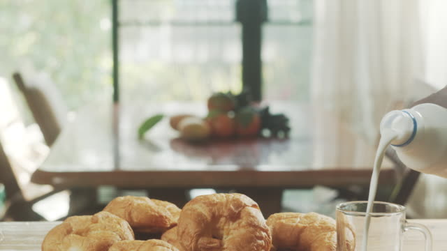 morning scene with croissant and milk on table - rustic stock videos & royalty-free footage