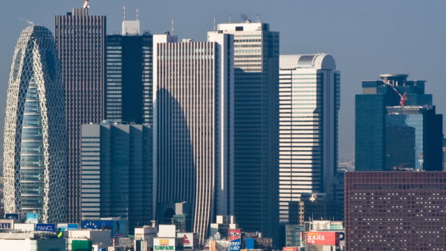 T/L MS HA Morning shadows passing over office buildings in East Shinjuku, Tokyo, Japan