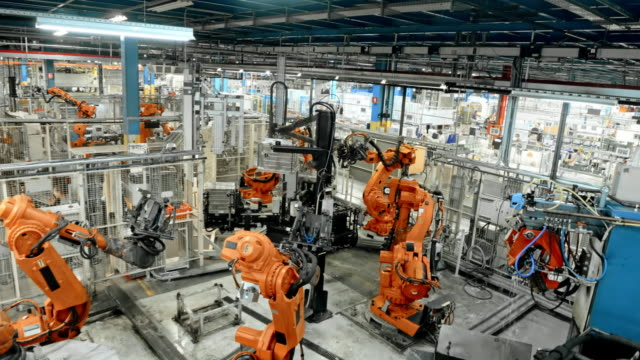 time-lapse morning start of the production in a factory with a robot production line - machinery stock videos & royalty-free footage