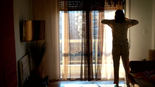 morning stretch near the window - blinds stock videos & royalty-free footage