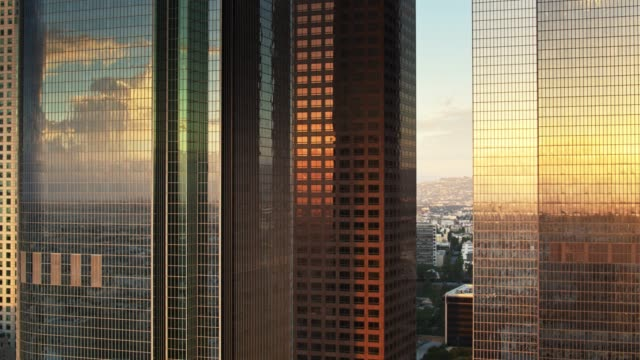 Morning Sun Glinting on Office Towers - Aerial Establisher