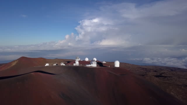 morning sun over the mauna kea observatory, aerial view. hawaii, usa - big island hawaii islands stock videos & royalty-free footage