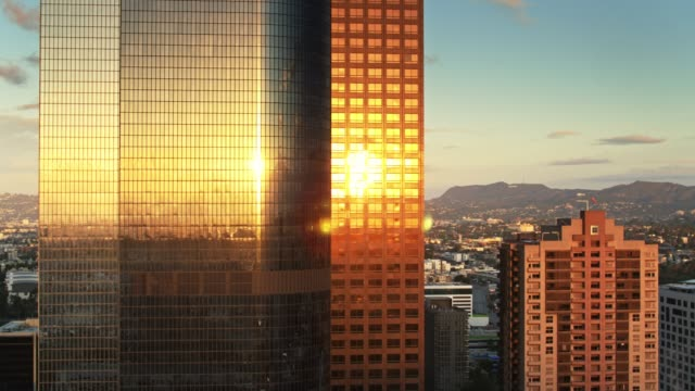 Morning Sun Shining on Office Towers at Sunrise - Aerial