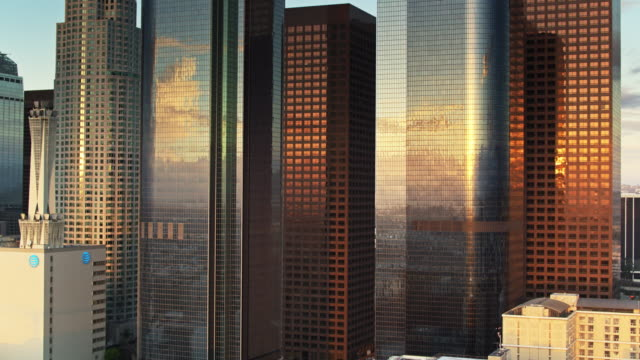 morning sunlight shining on office towers - aerial shot - tower stock videos & royalty-free footage