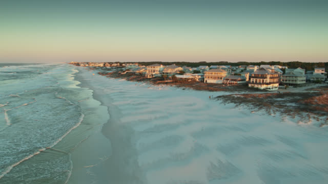 morning sunlight shining on white sand and houses of grayton beach, florida - drone shot - gulf coast states stock videos & royalty-free footage