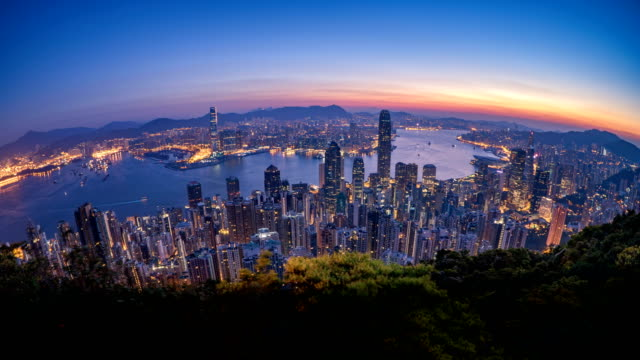 4k t\l morning sunrise over hong kong city taken from victoria peak - victoria harbour hong kong stock videos & royalty-free footage
