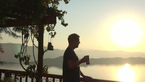 morning sunrise view male model drinking coffee - morning stock videos & royalty-free footage