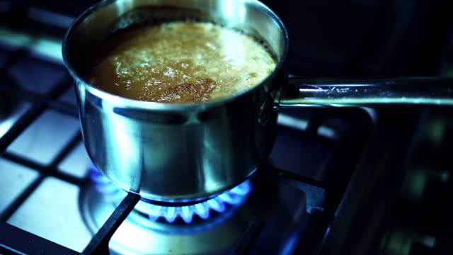 morning tea being prepared on the stove - milk tea stock videos & royalty-free footage