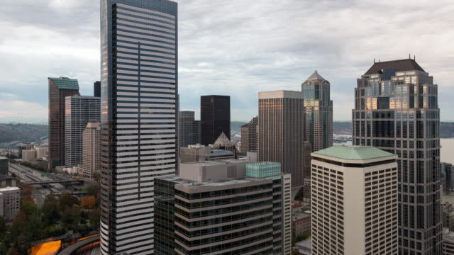Morning time lapse of downtown Seattle, with skyscrapers in the foreground on a partly cloudy day with slow moving clouds