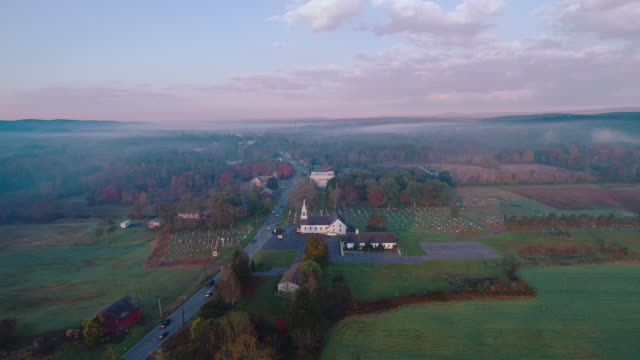 morning traffic in the small town brodheadsville in the appalachian mountains in poconos region, monroe county, pennsylvania. aerial drone video with the forward-panoramic camera motion. - small town america stock videos & royalty-free footage