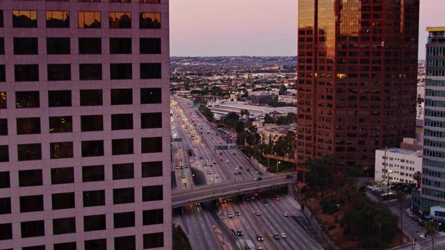 morning traffic on los angeles freeway - aerial - urban road stock videos & royalty-free footage