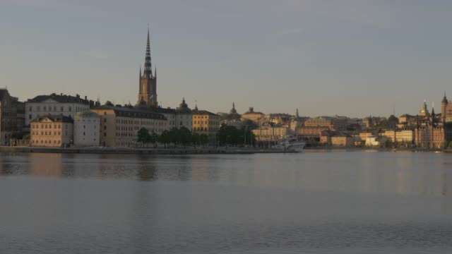 morning view of gamla stan across from town hall, stockholm, sweden, scandinavia, europe - circa 13th century stock videos and b-roll footage