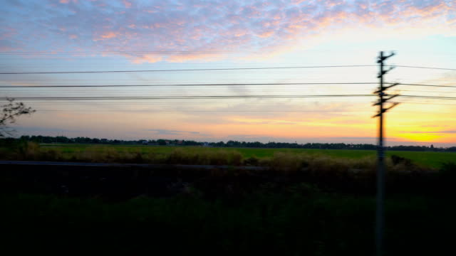 morning view taken from train window from ayutthaya to bangkok, thailand - mack2happy stock videos and b-roll footage