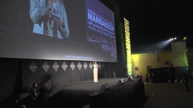 moroccan actor abadrahim tunssi receives the lifetime honorary award from moroccan actress hanane el fadili during the 16th marrakech international... - film festival stock videos & royalty-free footage