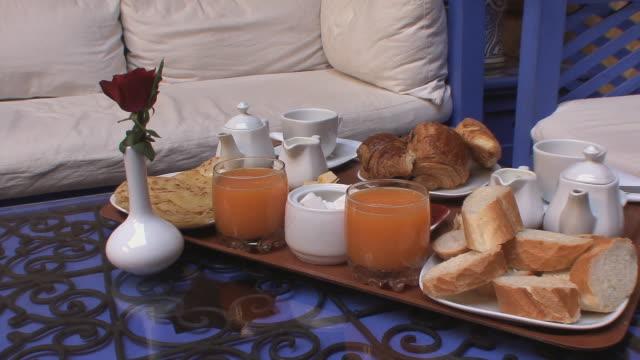 ms pan moroccan breakfast on table in hotel room, marrakech, morocco - モロッコ文化点の映像素材/bロール