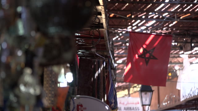 moroccan flag hanging in market - wiese stock videos & royalty-free footage